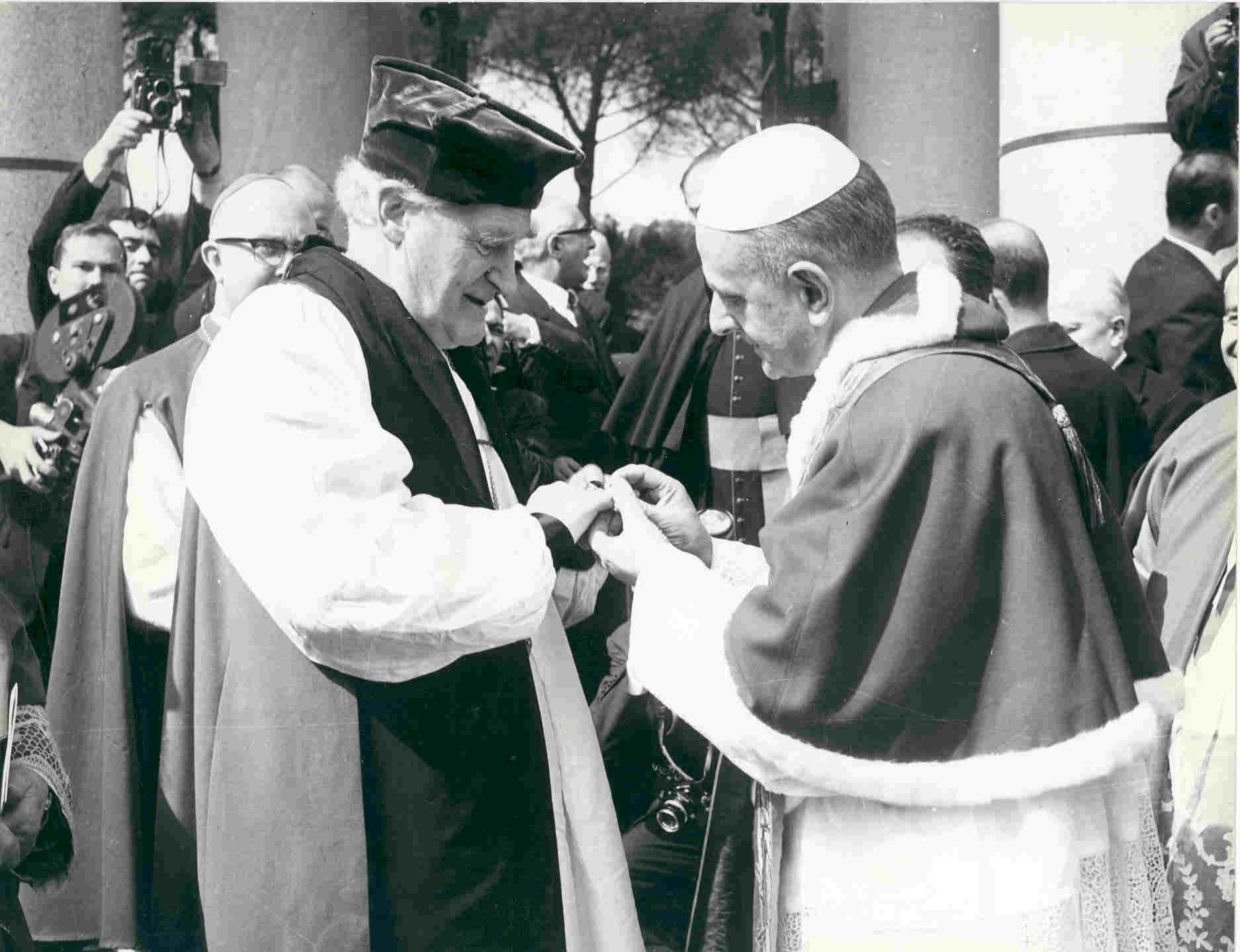 Pope Paul VI places his episcopal ring on the finger of the Anglican Archbishop of Canterbury Michael Ramsey