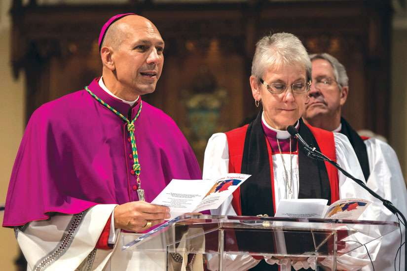 Saskatoon Bishop Don Bolen, left, presides with Anglican Bishop Linda Nicholls at a Nov. 9 ecumenical celebration of the 50th anniversary of the 1964 Decree on Ecumenism from the Second Vatican Council