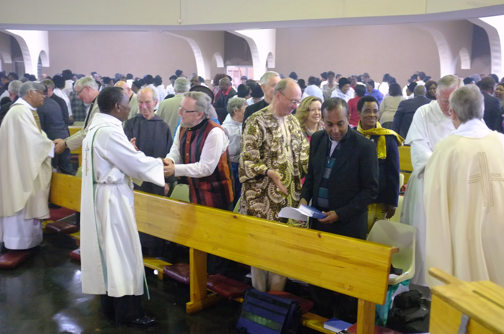 The sign of peace during the Anglican Eucharist at the ARCIC III meeting at Durban, South Africa (2014)
