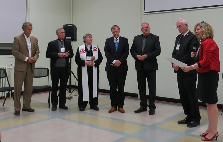 The induction of the Canadian Council of Churches executive for the new triennium. L-R: Larry Brennan, treasurer; Bishop Ron Fabbro, Vice President; the Rev. Canon Alyson Barnett-Cowan, President; the Rev. Stephen Kendall, Vice President; the Rev. Willard Metzger, Vice President