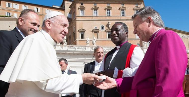 Pope Francis greets New Zealand Archbishop David Moxon, director of Rome's Anglican Centre, and Zambian Bishop William Mchombo of the Central African province at the end of his Wednesday general audience in St Peter's Square. Photo: Osservatore Romano