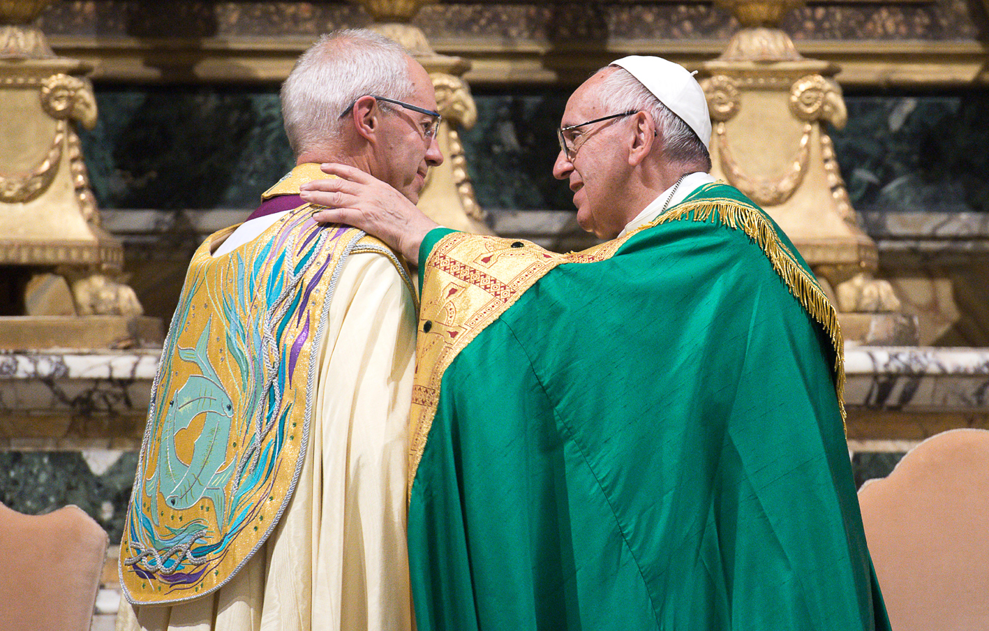 Pope Francis and Archbishop Justin Welby share a word and embrace during the Vespers at San Gregorio al Celio
