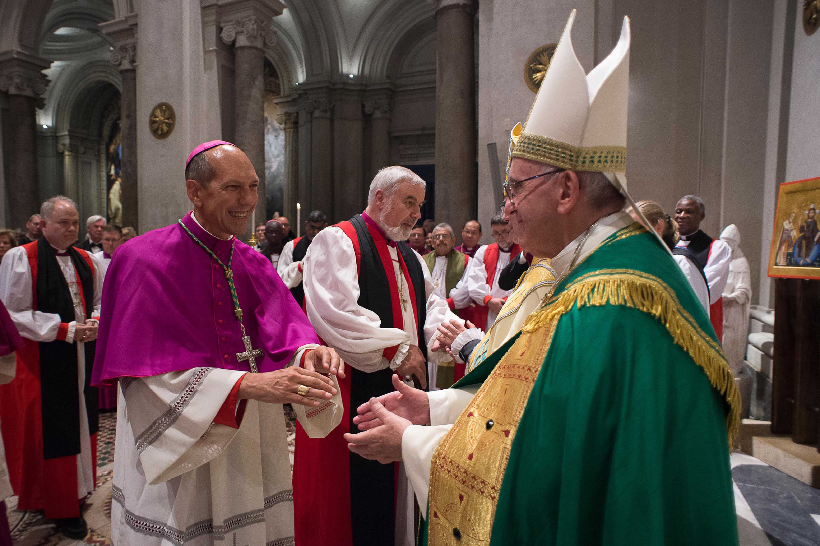Pope Francis greets Archbishop Donald Bolen, co-chair of IARCCUM, at the Vespers in San Gregorio al Celio