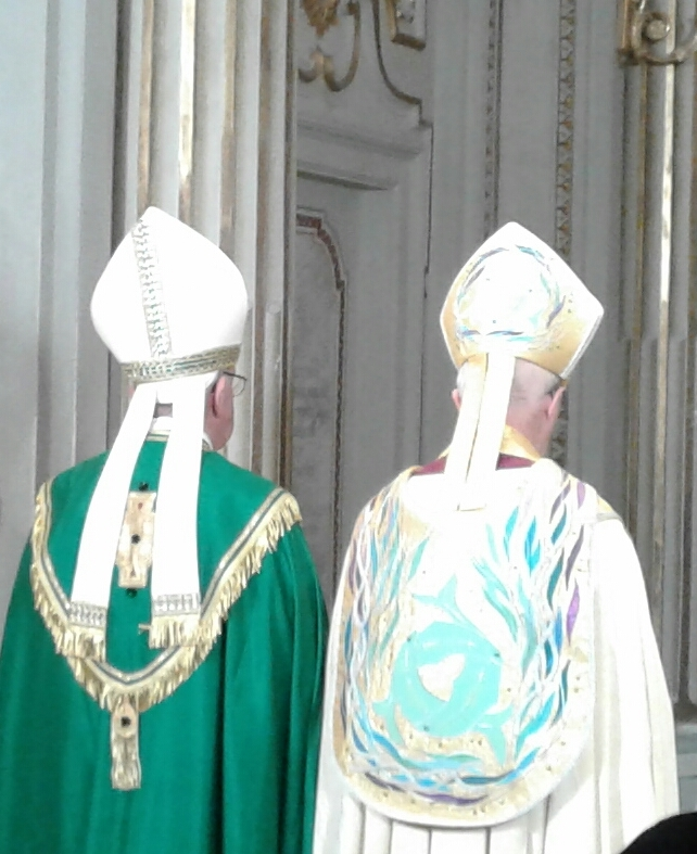 Pope Francis and Archbishop Justin Welby stop to pray at the throne of St. Gregory during the recessional after Vespers at San Gregorio al Celio