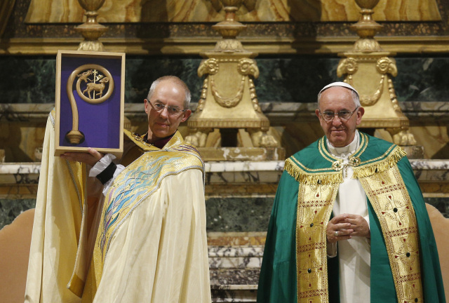 Anglican Archbishop Justin Welby of Canterbury, England, spiritual leader of the Anglican Communion, holds a replica of the crozier of St. Gregory the Great given by Pope Francis at a vespers service at the Church of St. Gregory in Rome on Oct. 5. Photo: CNS/Paul Haring