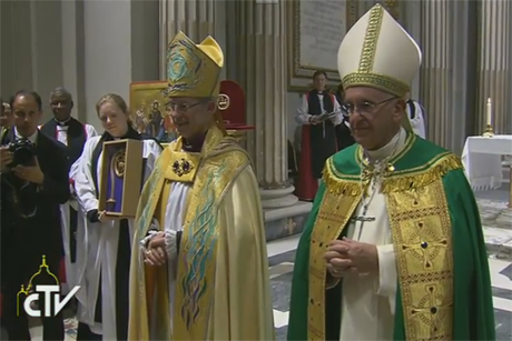 Archbishop Justin Welby and Pope Francis stand together in front of the congregation at the Vespers at San Gregorio al Celio