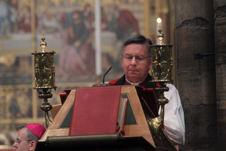 The Anglican Communion's spymaster general? Archbishop David Moxon, director of the Anglican Centre in Rome, reads a lesson during a special service of choral evensong at Westminster Abbey, marking the centre's 50th anniversary