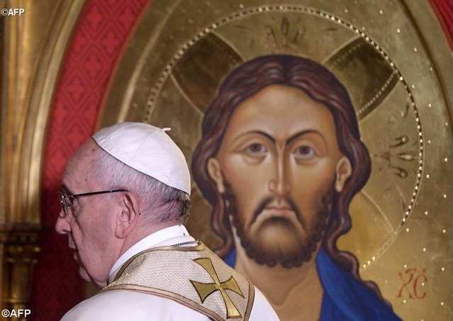 Pope Francis passes in front of an icon of Jesus Christ during his visit at the All Saints' Anglican Church in Rome. Photo: AFP