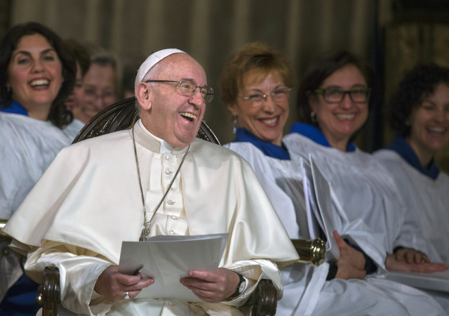 Pope Francis laughs during an evening prayer service at All Saints' Anglican Church in Rome Feb. 26. It was the first time a pope has visited an Anglican place of worship in Rome