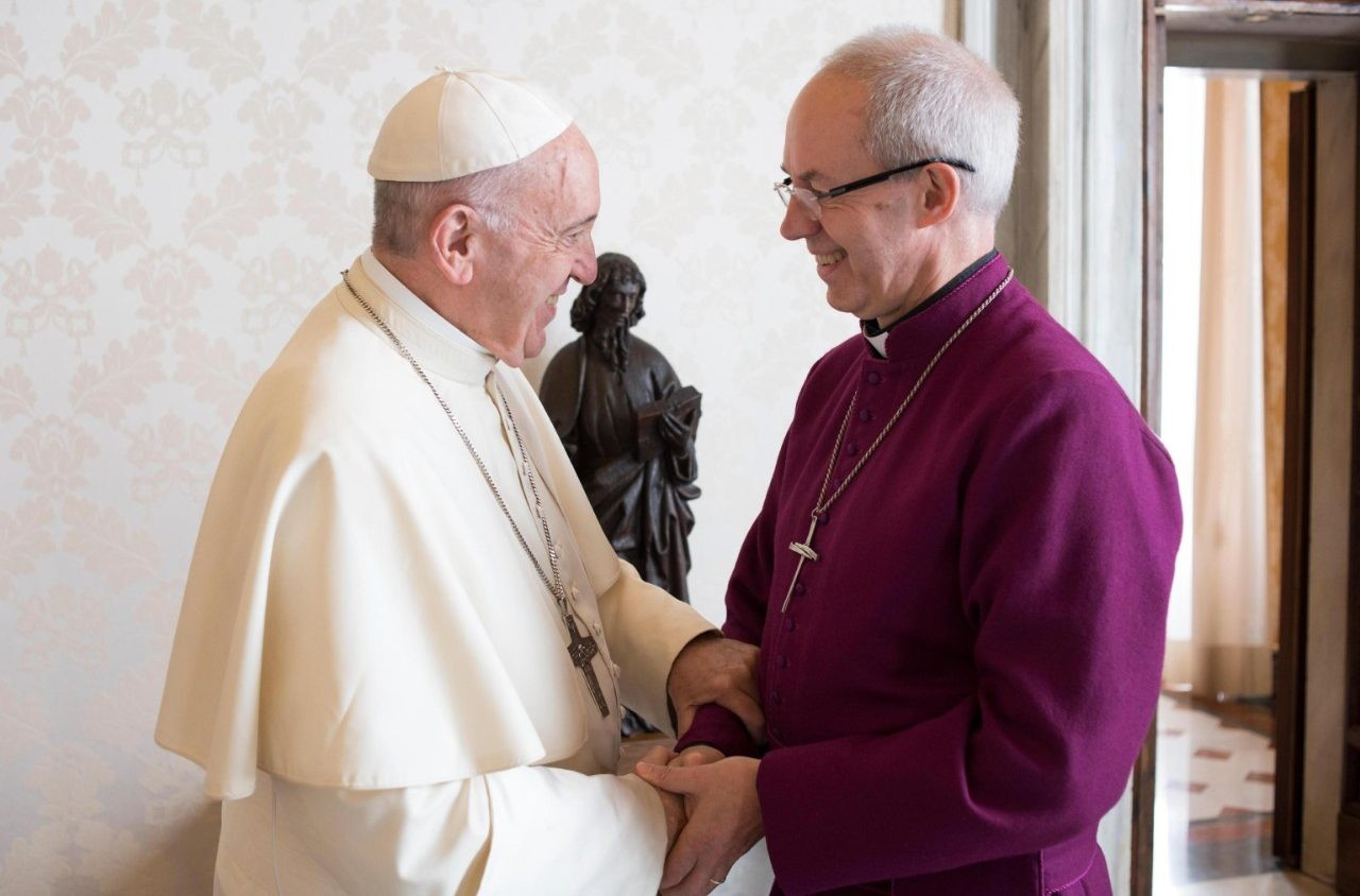 Pope Francis greets Archbishop of Canterbury Justin Welby during a private audience at the Vatican Oct. 27, 2017