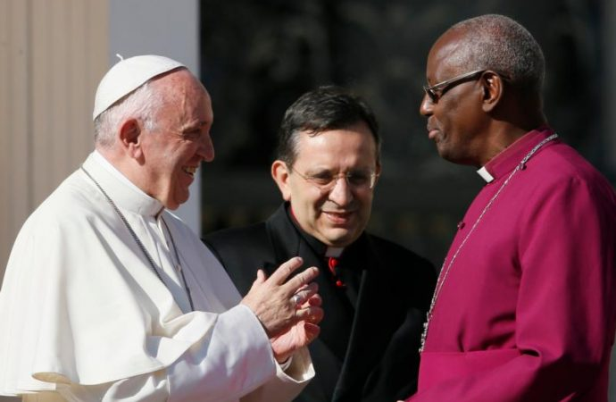 Pope Francis greets Anglican Archbishop Bernard Ntahoturi, director of the Anglican Center in Rome and the archbishop of Canterbury's personal representative to the Holy See, during his general audience in St. Peter's Square at the Vatican Nov. 8, 2017. The Anglican-Roman Catholic International Commission July 2 published its first document in 13 years on how both institutions can learn from each other in the exercise of ecclesial authority locally, regionally and globally. Credit: Paul Haring/CNS
