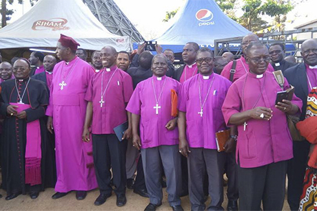 The Anglican and Roman Catholic Archbishops of Uganda, Stanley Ntagali and Cyprian Kizito Lwanga, with bishops from the two churches at the Ugandan Martyrs Shrines in Namugongo