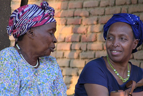 Mathilde Nkwirikiye (right) chats with the grandmother of one of the recipients of a St Timothy Scholarship. Photo: Cristiano Barbarossa