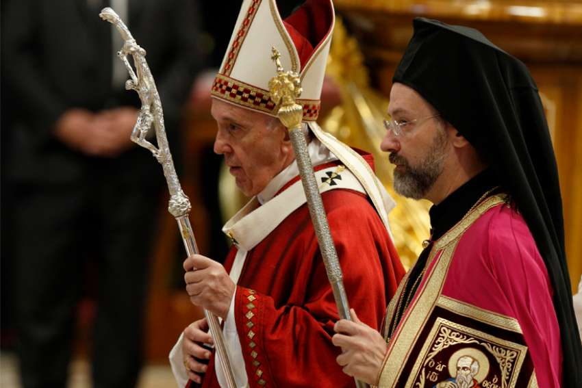 Pope Francis walks with Orthodox Archbishop Job of Telmessos as they leave Mass marking the feast of Sts. Peter and Paul in St. Peter's Basilica at the Vatican June 29, 2019. Archbishop Job was representing the Ecumenical Patriarchate of Constantinople
