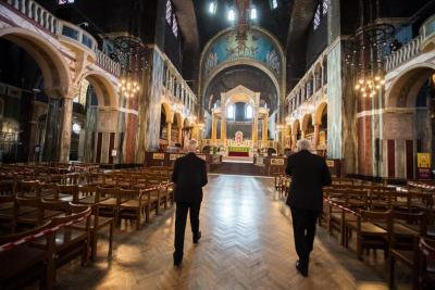 Cardinal Vincent Nichols and Archbishop Justin Welby walk down the aisle of Westminster Cathedral