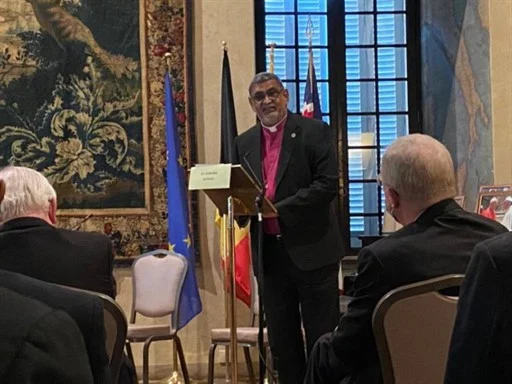 Archbishop Ian Ernest speaking at the Malines Conversations Conference